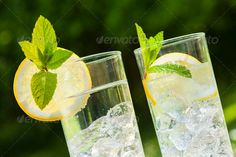 cold summer drinks in garden ...  background, beverage, bright, chilled, clear, close up, cool, cooled, drink, flowers, fresh, garden, glass, glasses, golden, grass, green, healthy, herbs, home made, ice, ice cubes, lawn, lemon, lemonade, lime, makro, mint, refreshing, slice, soda, summer, sun, sunlight, sunshine, table, water, wood, wooden, yellow