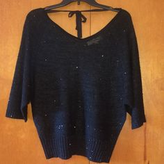 Black sequined sweater Think black sequined sweater. Loose fitting with 3/4 sleeves. V-neck in front and back with cute drawstring tie in back as well. Size is XS but fits more like a S/M. LOFT Sweaters V-Necks