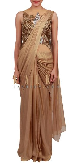 Buy Online from the link below. We ship worldwide (Free Shipping over US$100) http://www.kalkifashion.com/gold-saree-gown-features-with-cowl-drape-and-embellished-bodice-only-on-kalki.html