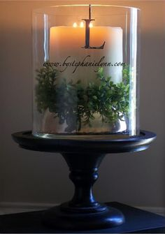 Boxwood with candle and love the vinyl monogram!