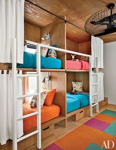 In a Cascade Mountain home, Olson Kundig Architects designed the bunk room's plywood beds, which are dressed with Garnet Hill linens that echo the colors of the Flor carpet tiles. Bunk Bed Rooms, Bunk Beds Built In, Cool Bunk Beds, Kids Bunk Beds, Amazing Bunk Beds, Rustic Kids Rooms, Bunk Bed Designs, Kids Room Design, Loft Spaces