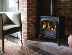 The Bloomsbury stove from Acquisitions Fireplaces is DEFRA approved for use in smoke control zones. Home Fireplace, Modern Fireplace, Fireplaces, Pop Up Tv Cabinet, Inset Stoves, Stoves For Sale, Multi Fuel Stove, Traditional Fireplace