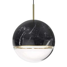 The Wandering Star LED Pendant Light features a beautiful dual-toned globe that mixes solid stone with glass.