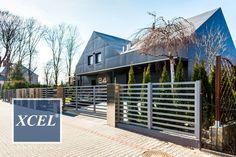 Nowoczesne minimalistyczne ogrodzenie aluminiowe xcel horizon lite. stal nierdzewna, włóknocement