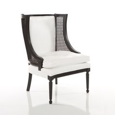 Reed Chair: Hollywood Regency-style white crocodile caned wingback chairs are perfectly chic, but walk a bit on the wild side.