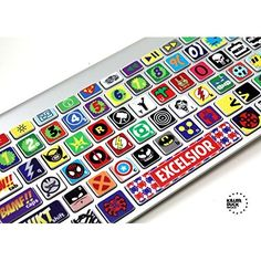 Macbook Keyboard Super Hero Skin / Vinyl Decals  These are vinyl laminated skins, individually cut for each key. Not to be confused with silicon or rubber skins, although a clear silicone skin / cover will work over top of our skins/ decals. Decals for your Apple Keyboards. Modeled after some of the greatest heroes and villains of all time. Apple Wireless and Macbook keyboard Skin. Fits all Macbook keyboards, with the exception of the Mackbook 11 Air. Does not interfere with the backlit…