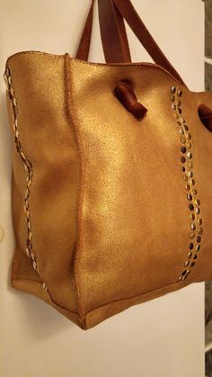 Gorgeous Leather Bag for Women, Shoulder Hand Bag with Boho chic  Spacious, sophisticated and chic, this gorgeous gold tote leather embellished with studs, is a must-have leather bag. It is roomy, functional and versatile, with two handles to carry over your shoulder.  You can use it everywhere every day and for any occasion, and it will add charm, elegance and sophistication to your appearance.  This bag is made with love for high quality materials, fine craftsmanship and beautiful boho…