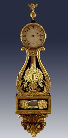 Lyre Clock, 1838, Edmund Currier, Salem, MA, Gilt-wood, eglomise (reverse painting on glass), brass, Peabody Essex Institute.