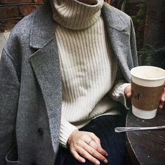 duster jacket + cream turtleneck + coffee + androgynous