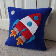 This item is sold but a similar one will be made to order, please allow a couple of extra days for delivery Snuggly royal blue fleece Space Rocket cushion.    Removable  polar fleece cover with fleece Rocket applique, includes (an approx)  18 x 18 inch...