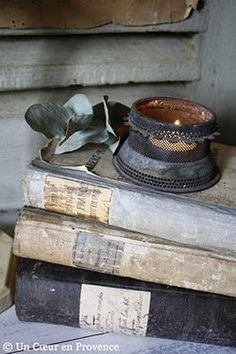 Old books, I just love the muted colours of the aged books and the metal candle holder. Old Books, Antique Books, Vintage Books, Stack Of Books, I Love Books, Gris Taupe, Book Letters, Provence, Grey Home Decor