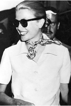 Smiling Grace Kelly arriving at Claridge's in London wearing an Hermès twilly scarf, 1967.