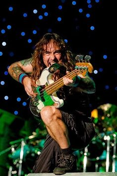"Steve"" Harris is an English musician and songwriter, known as the bassist, occasional keyboardist, backing vocalist, primary songwriter and founder of the British heavy metal band Iron Maiden. He is the only member of Iron Maiden to have remained in the band since their inception in 1975 and, along with guitarist Dave Murray, to have appeared on all of their albums..."