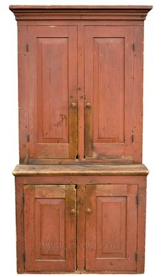 """Step Back Cupboard, Original Red paint  Found In Maine  19th Century.Molded cornice above pair of raised-panel doors; protruding base with matching doors. In very good condition with dry surface.  (Height: 80""""; width: 40""""; top depth: 11.75""""; bottom depth: 21.75"""")"""