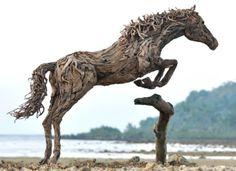 BNPS.co.uk (01202 558833) Pic: JamesDoran-Webb/BNPS ****Please use full byline**** Jumping horse on Cebu beach in the Philippines. These maj...