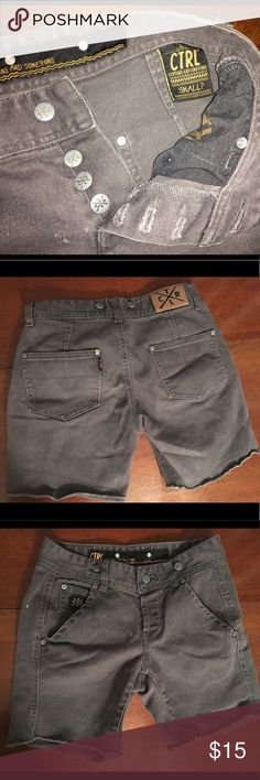 CTRL Dark Grey Shorts w. Suspender Option Solid CTRL shorts in a rugged dark grey look with a green paint stain and two markings on the front of the shorts (noted in the photos). These are used cut off jean shorts still in great condition. CTRL Shorts Jean Shorts