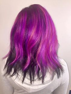 Healthy hair. All natural African American hair. Pink and purple