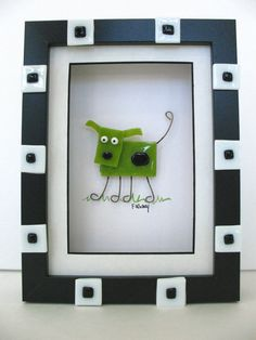 "Whimsical green fused glass dog picture by FaithWickey on Etsy  shadowbox frame that's 6 1/4"" x 8 1/4"" x 1"" deep with black and white pieces of glass on the front of the painted wood frame.  $55-65"