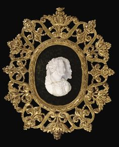 A CARVED AJOURE CHALCEDONY DOUBLE PORTRAIT PROFILE CAMEO OF A MAN AND WOMAN  16TH CENTURY