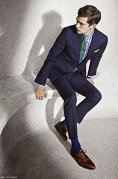 Green and Blue are trending for Spring 2015. Achieve this look in the office with a kelly green tie, navy suit, light neutral shirt, and matching coffee brown accessories.