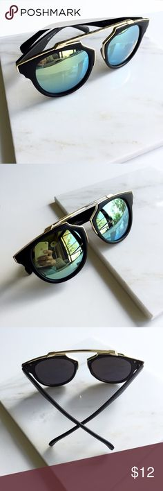 """So Real Black Green Mirrored Cat Eye Sunglasses So cute, so fun. Get the So Real look without the price. Black Matte frames with gold green mirrored lenses and gold metal accents and brow bar. 100% UV protection. 5.8"""" W x 2.1"""" H. Available 4 other colors. Price is firm unless bundled. Bundle 4 or more and save 20%. Accessories Sunglasses"""