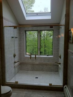 Shower with window. Love the forest in the background.