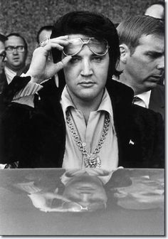 Elvis Presley is reflected in the roof of his automobile as he looks into the camera after attending a luncheon January 16, 1971 at what was then the Holiday Inn Rivermont. The luncheon was part of the festivites surrounding his being named one of the Jaycees of America's Ten Outstanding Young Men in America.