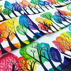 Remember these bare branches? Rainbow tops, texture swirls, and ground added! New project inspired by trees on artist Kristen Bailey's blog. #rainbowtrees #rainboworder #colorfultrees #watercolorandsharpie #rainbowland #creativelandscape #4thgrade #paintingtrees
