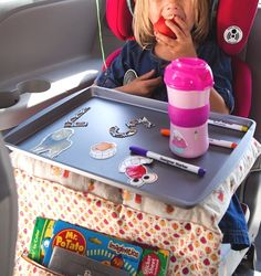 We used a cookie tray to play with stickers and magnets for our drive to Florida last year.  It was a great idea.