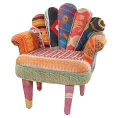 Multicolor peacock arm chair with a mango wood frame and scalloped back. Made with reclaimed vintage kantha throws.Product: Chair...