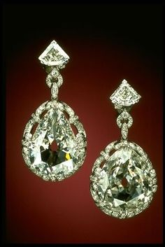 MARIE ANTOINETTE'S PEAR SHAPED DIAMOND EARRINGS    These two large, pear-shaped diamonds weigh 14.25 and 20.34 carats respectively, and are originally from India or Brazil, the only significant sources of diamonds in the eighteenth century. The diamonds were supposedly set in earrings that belonged to Marie Antoinette, the queen of France who was guillotined in 1793 during the French Revolution.  The earrings appear to have stayed in the French royal family.