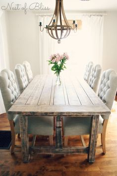 Chairs like this without arms might be nice. I like the combo of kind of rustic table and more formal chairs. Other option is wood side chairs with two different upholstered head chairs. Not sure of colors.