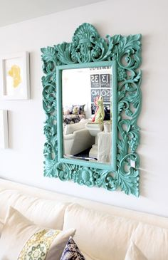 I think this would be fun with one of those tacky, old gold, frames that used to be so popular.  I would under-paint it with hammered bronze spray paint first, then go over it with the turquoise (or another color) but not completely cover up the bronze.  Then of course you would have to have a mirror cut to fit, but that is pretty inexpensive.  Would be such a FUN project!  LOVE IT!!