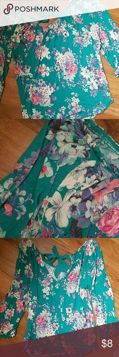 Lauren Conrad Casual Blouse Lauren Conrad Casual Blouse. Turquoise with multiple colored floral design. Size small. Pretty ribbon closure in the back! Sleeves are slightly longer than 3/4 IMO.   Condition is 8/10 to be safe, very mild wash wear. Lauren Conrad Tops Tees - Long Sleeve