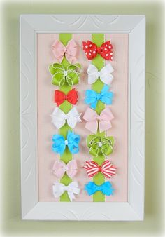 This stylish DIY ribbon board serves as wall art AND a place for her to stash all her bows.