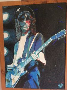 "Jimmy Page in his ""Stormtrooper Outfit"" which included various, sunglasses, suspenders, and a hat resembling a German WWII SS Visor. Here Jimmy is carved on wood and acrylics used.  Work done by Bruce J Schmalfuss"