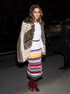 Arriving at the Carolina Herrera show, Olivia layered a fur coat over her white sweater and printed skirt b...