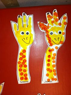 Giraffe Handpint:  I painted the students' arm and hand minus the thumb.  When dry, I added the outline, cut them out, and had the students add the dots and eyes.  This was a simple, fun, and cute first day project for our Giraffe Class.