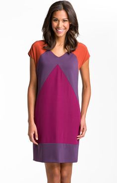 Any dress style that hangs in a straight line from the shoulder will flatter the apple shaped figure like shown above. Avoid A-line dresses and other dresses with a gather at the waist, as these styles will make your midsection look larger than it is. The key is to choose a dress that's full enough to hide your figure, but not so full as to be baggy.