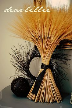 Wheat and black ribbon represent mourning...but love the colors and texture