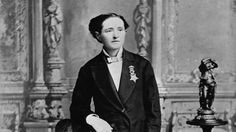 Black and white portrait of Dr. Mary Walker wearing a man's suit.