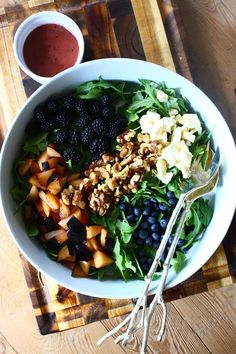 Summer Salad with Brie, Plums, Glazed Walnuts and a Blueberry Balsamic Vinaigrette