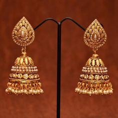 Anvi's designer pearl jhumkas with white stones
