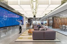 Inside Uber's San Francisco headquarters, the main lounge's LED-embedded touch-screen video wall maps Uber cars in all 100 cities served. Photography by Jasper Sanidad. Interior Design Magazine, Open Office, Cool Office, Office Lounge, Corporate Interiors, Office Interiors, Interior Office, Commercial Design, Commercial Interiors