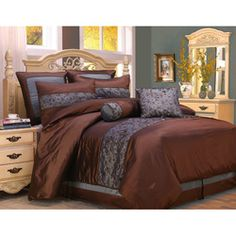 @Overstock - This embroidered 8-piece comforter set features warm, rich colors of blue and brown to add depth to your bedroom. Embroidered petal patterns adorn this luxurious set, which comes with a comforter, shams, bedskirt, and two decorative pillows. http://www.overstock.com/Bedding-Bath/Fritzi-Blue-and-Brown-Queen-8-piece-Comforter-Set/5909641/product.html?CID=214117 $77.59