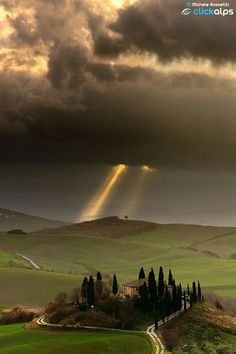 light breaking through dark clouds over Italy