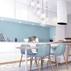 Love the use of color with the backsplash and chairs tying it together.