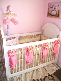 I like the Bows Decorating the Crib - Will probably do the same, except I'll make my own with fabric that matches the bed set (: