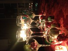 Wine glasses, Christmas ornaments and candles- beautiful!