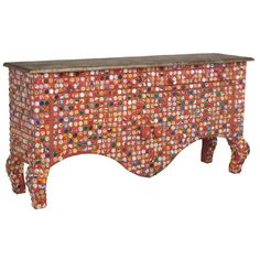 The Bottlecap sideboard is repurposed art at its best! A bright red finish and reclaimed bottle cap mosaic on this sideboard create a colorful blast of fun to your Ethnic Eclectic Style.